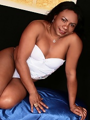 Smooth chocolate shemale in white lingerie solo